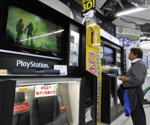 A customer watches a monitor of Sony's v