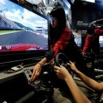 A video game fan tries a driving simulat