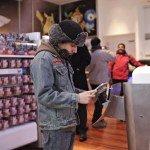 Lou Garzon plays Yoshi's Island on a Nintendo DS Lite handhe