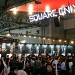 Visitors look at Square Enix Co.'s video game titles display